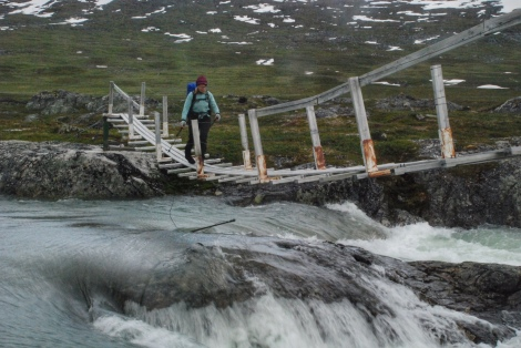 Crossing a bridge in Norwegian Mountains